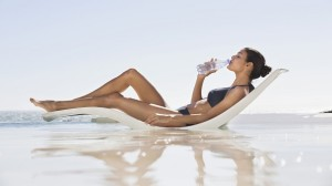 Water will keep you hydrated and your skin soft during your tanning time