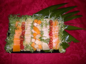 Cheese_tray_garnished_with_red_pepper_rings_and_chicory