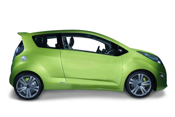 New fuel efficeint hybrid car design. The smaller modern looking design is the future of the industry. Isolated on a white background with a shadow detail drawn in for you. A pen tool clipping path is included for the car, minus the shadow.