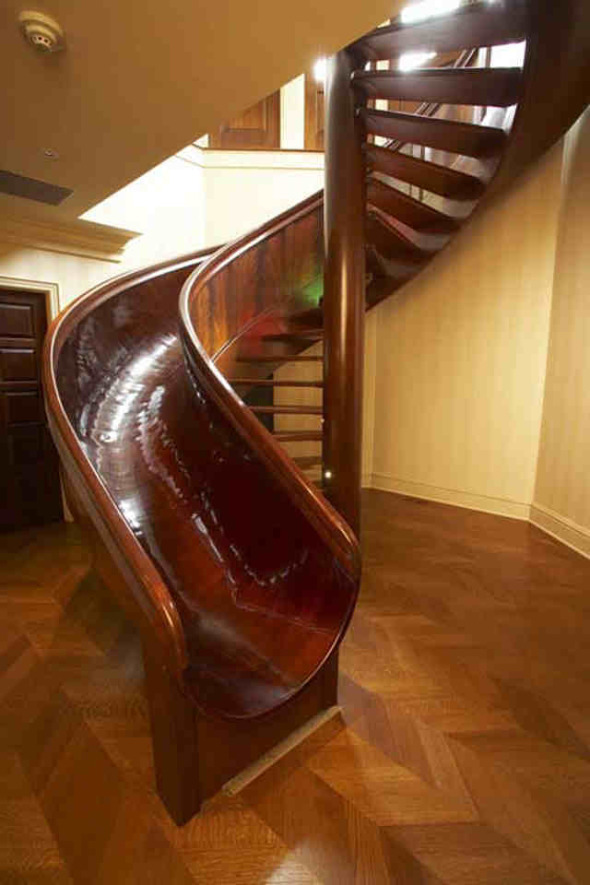 wooden-spiral-staircase-with-slide-beside-it-1