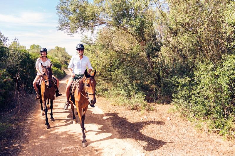 Young,Tourist,Couple,Horseback,Riding